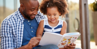 father and daughter read a book